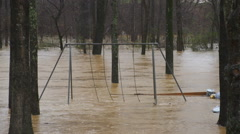 Muddy flood waters submerge playground Stock Footage