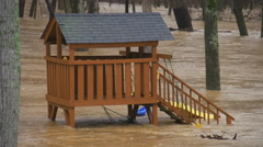 Flooding overwhelms children's jungle gym - stock footage
