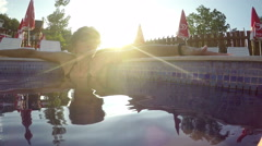 Femele sexy model enjoy spa thermal pool at sunset Stock Footage