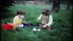 Children inspect their new found Easter Eggs - 3039 vintage film home movie Stock Footage