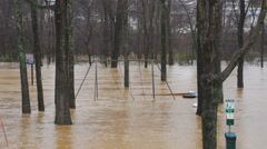 Flood waters overwhelm playground Stock Footage