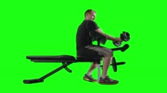 LS Man Doing Bicep Curls on Exercise Bench with Green Background 4K - stock footage