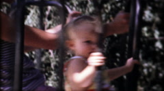 3045 mother & daughter spin on the merry go round - vintage film home movie Stock Footage