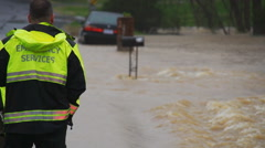 Emergency crew at flooded street Stock Footage