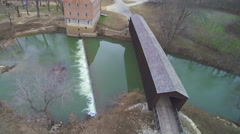 4K flyover historic covered bridge and mill - stock footage