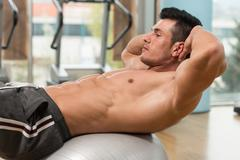 Doing Sit-Ups Abdominal Crunch - stock photo
