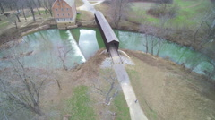 Old mill and historic covered bridge from high above - stock footage
