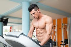 Young Man On Treadmill Stock Photos