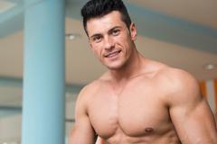 Young Man On Treadmill Stock Photos