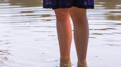 Girl standing in water - stock footage