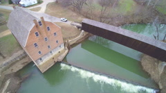 Stock Video Footage of Gorgeous overhead shot of old mill and covered bridge