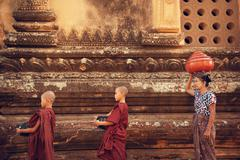 Buddhist novice monks collect alms Stock Photos