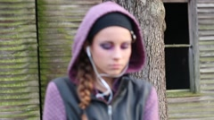 Camera Movement and Soft Focus on Pretty Pre-Teen Girl with Earphones - stock footage