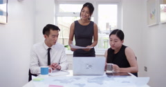 Asian colleagues discuss future business ventures. Stock Footage