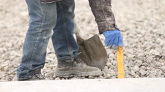 Worker distributes gravel Stock Footage