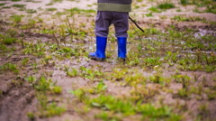 Close up of toddler in rubber boots. Stock Footage