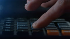 Finger presses the button calculator. closeup and  shallow depth of field Stock Footage