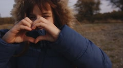 Girl looks at the heart Stock Footage