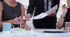 Confident young Asian business team in a meeting. Shot on RED Epic. - stock footage