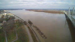4K pan left to right of flooded Mississippi River and suspension bridge Stock Footage