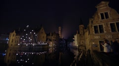 Night canal, tourists take photo of reflections in Bruges, Belgium Stock Footage