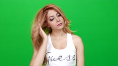 Beautiful Woman Combing Her Hair on Green Screen Stock Footage