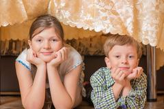 Portrait a fullface of the smil girl and the boy - stock photo