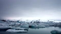 Blue icebergs floating on Jokunsarlon glacial lagoon BMPC4K Stock Footage