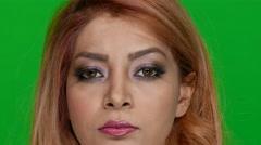 Beautiful Woman Raising Her Eyebrows on Green Screen - stock footage
