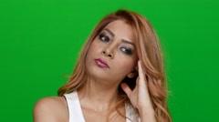 Beautiful Woman Thinking on Green Screen Stock Footage