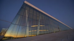 Oslo Opera House, iceberg-like foyer glass exterior at dusk Stock Footage