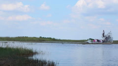 Taking an airboat ride through the Florida Everglades in summer Stock Footage