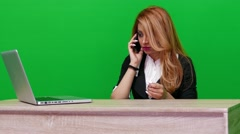Business Woman Talking on a Phone on Green Screen - stock footage