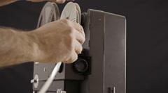 Super 8 projector inserting film Stock Footage