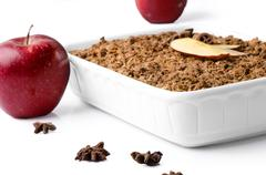 Christmas still life consisting of red apples, star anise and apple crumble a - stock photo