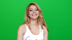 Happy Blond Girl Smiling on Green Screen - stock footage