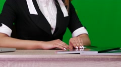 Medium Shot of a Woman Reading a Magazine on Green Screen Stock Footage