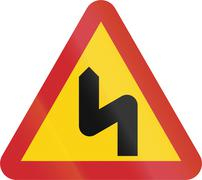 Road sign used in Sweden - Dangerous curves ahead, first to left - stock illustration