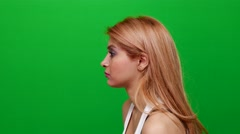 Sad and Crying Woman From a Side Angle on Green Screen - stock footage