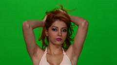 Seductive Woman Playing With Hair on Green Screen - stock footage