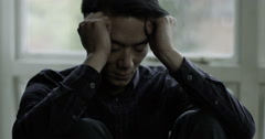 Shot of a young Asian man having relationship problem. Shot on RED Epic. Stock Footage