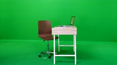 Sexy Business Woman Sitting Down at a Desk on Green Screen Stock Footage
