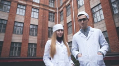 Healthcare and medical concept - video of two young attractive doctors in - stock footage
