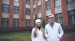 Portrait of cheerful smiling male doctor and female Stock Footage