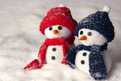 Photo of three hand made snowman in blue color and red - optimal decoration f - stock photo