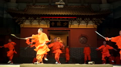 Shaolin temple monks are practicing martial skills on the stage for the tourists - stock footage