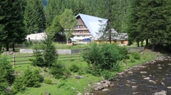 Cottage near mountain river, Carpathians, Ukraine Stock Footage