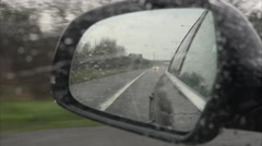 4K Reflection in Car Side Mirror Driving in Rain Stock Footage