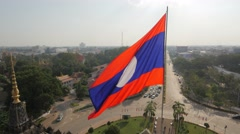 Lao national flag on top of Patuxai monument,Vientiane,Laos Stock Footage