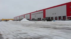 cell warehouse with parking snow area - stock footage